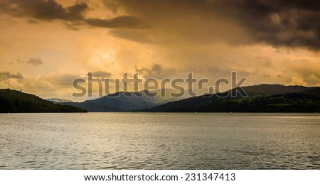 A unique moody/stormy view across Lake Windermere on the edge of a dark storm with dark/contrasting lighting