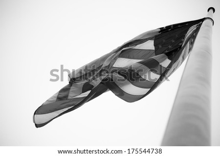a united states flag in the wind - stock photo