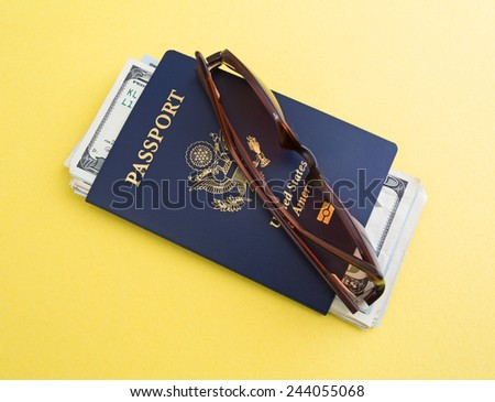 A United States Passport, sunglasses and vacation cash atop a yellow background.