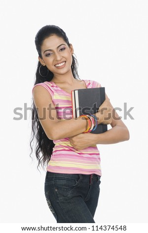 A university student carrying books