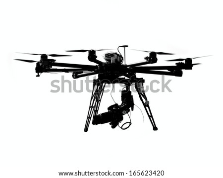 A unmanned aerial vehicle or drone with a camera mounted on it  - stock photo