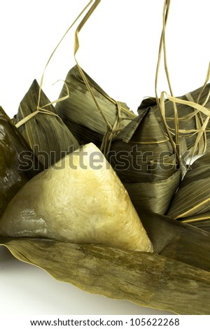 A unwrapped dumpling among the rest of the dumplings on white isolated background. - stock photo
