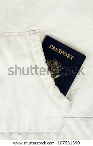 a US passport in white jacket pocket - stock photo