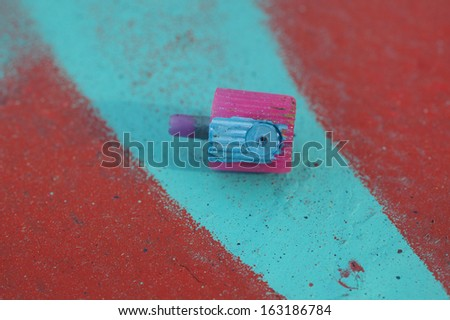 A used aerosol spray paint can cap - stock photo