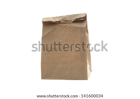 A used brown paper bag on a white background. - stock photo