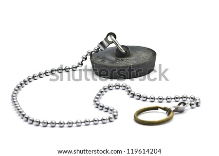 A used sink plug on a chain. - stock photo