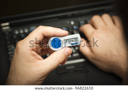 A user enters a second factor authentication password at log on - stock photo