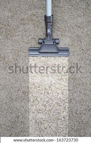 A vacuum cleaner isolated against a white background - stock photo