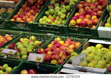 A variety of apples at a grocery store - stock photo