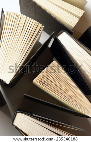 A variety of books from an overhead viewpoint. - stock photo