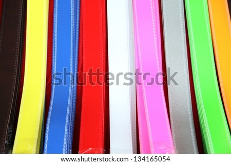A variety of colorful belts for sale - stock photo