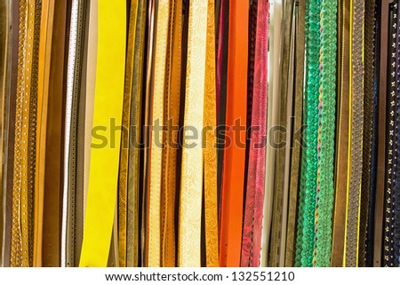 A variety of colourful belts for sale