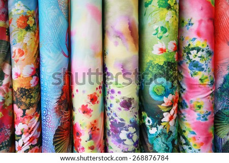 A variety of different bolts of colorful silk fabric  - stock photo