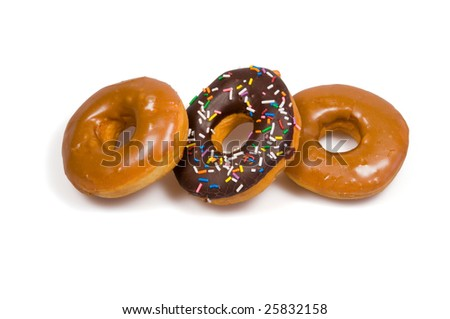 A variety of donuts in a row against a white background