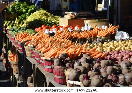 A variety of fresh vegetables for sale at a local market - stock photo
