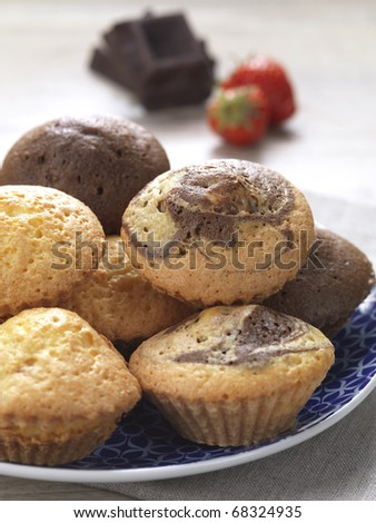 a variety of muffins in a plate