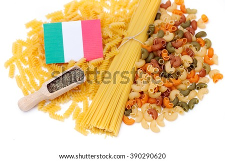 a variety of pasta with seasoning and Italian flag - stock photo