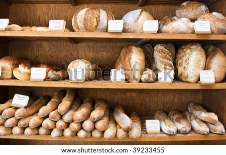 A variety of rustic loaves at a bakery in Quebec. - stock photo