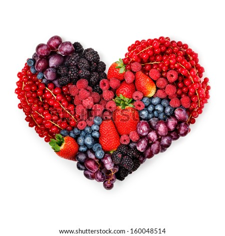 A variety of summer berries in the shape of heart as a symbol of valentine and love. - stock photo