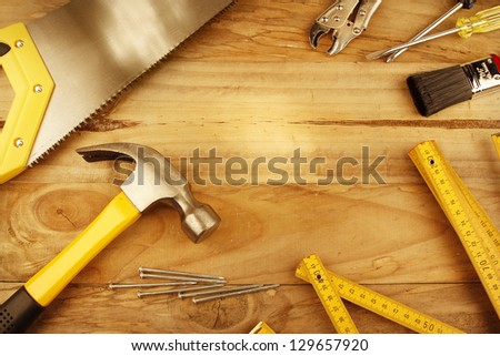 A variety of tools on wood. Advertising space - stock photo