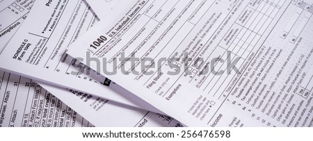 A variety of United States tax forms with a pencil - stock photo