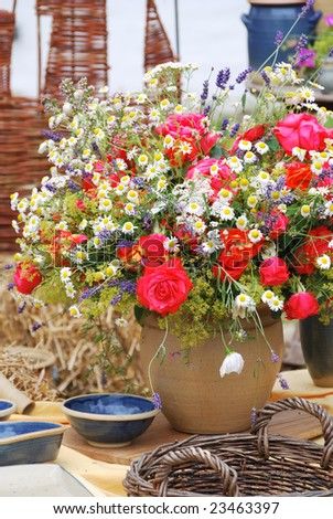 A vase full of colorful flowers - stock photo