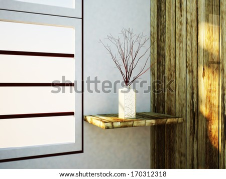 a vase with the  branches near the window - stock photo