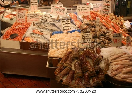 A vast array of fish awaits the shopper at Pikes market in seattle Washington - stock photo