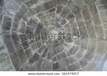 A vault, built of gray stone blocks