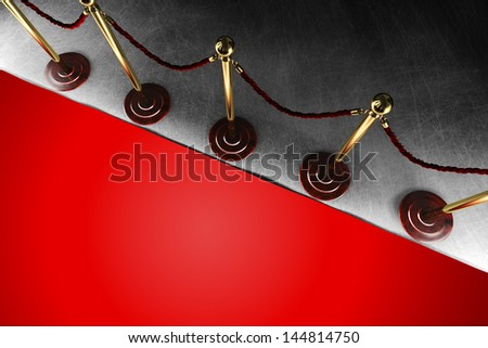 A velvet rope barrier with big red carpet in top view - stock photo