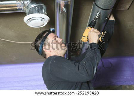 A ventilation cleaner check for dust on it. - stock photo