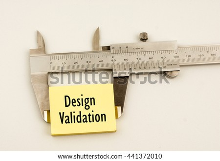 A vernier caliper and yellow note with word design validation  - stock photo
