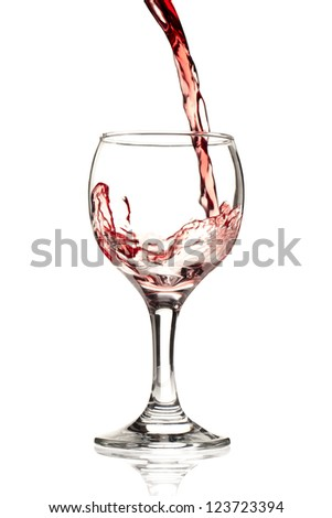 A vertical image of red wine pouring on the goblet isolated on the white background - stock photo