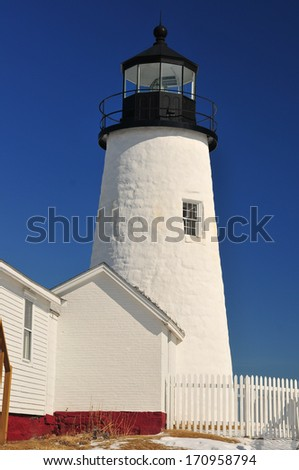 A vertical of the Pemaquid Lighthouse Light tower on the Maine Coast on a beautiful winter day - stock photo