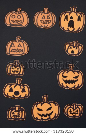 a vertical overhead view of a halloween frame made by pumpkins