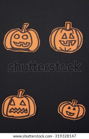 a vertical overhead view of some Halloween drawings of pumpkins
