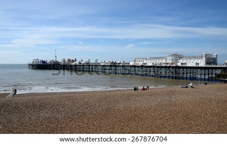 A vertical panoramic view of the iconic and historic Brighton Pier on a beautiful spring day. Brighton, UK - stock photo