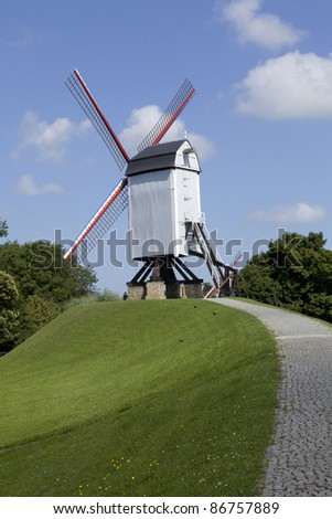 A vertical shot of one of the windmills in Bruges Brugges in Belgium, Europe. - stock photo