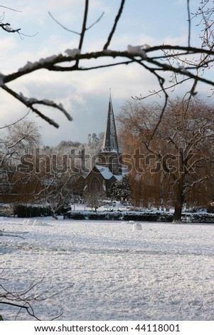 A vertical shot of the church in Godalming, Surrey taken from the park during the big freeze of January 2010 - stock photo