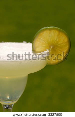 A vertical view margarita with a slice of lime - stock photo