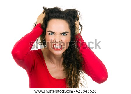 A very angry and frustrated woman is pulling her. Isolated on white. - stock photo