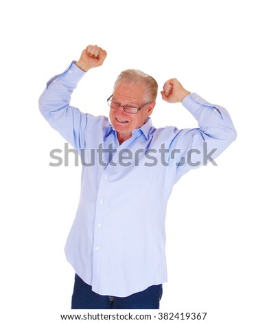 A very angry senior man with his arms raised and a grim face standing in