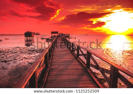 A very beautiful Sunset with orange skies and bridges on the beach