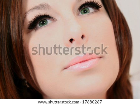 a very beautiful woman's face in close up - stock photo
