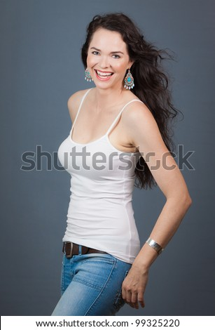 A very beautiful young woman laughing and looking at camera - stock photo
