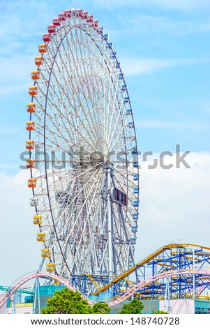 A very big ferris wheel in Yokohama City, Japan under bright blue sky. - stock photo
