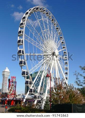A very big ferry wheel in Niagara Falls under bright blue sky. - stock photo