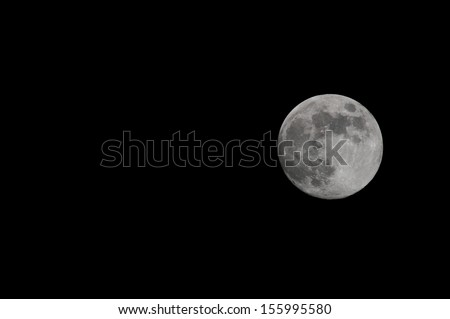 A Very Big Full White Moon on the Black of the Night - stock photo