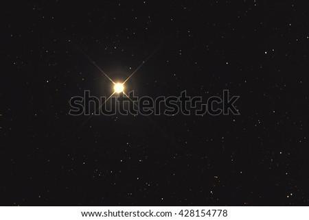 A very bright yellowish star named Alpha Centauri or Regil Kentaurus in the constellation Centaurus taken with CCD camera and medium focal length telescope - stock photo