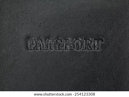 A very close view of a black leather passport holder. - stock photo